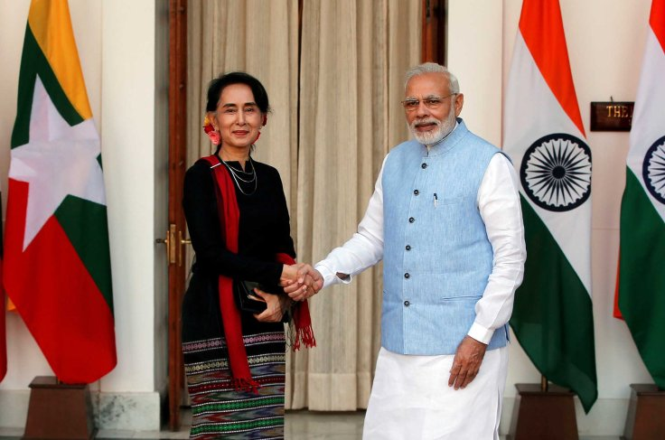 Myanmar's State Counsellor Suu Kyi shakes hands with India's Prime Minister Modi during a photo opportunity ahead of their meeting at Hyderabad House in New Delhi